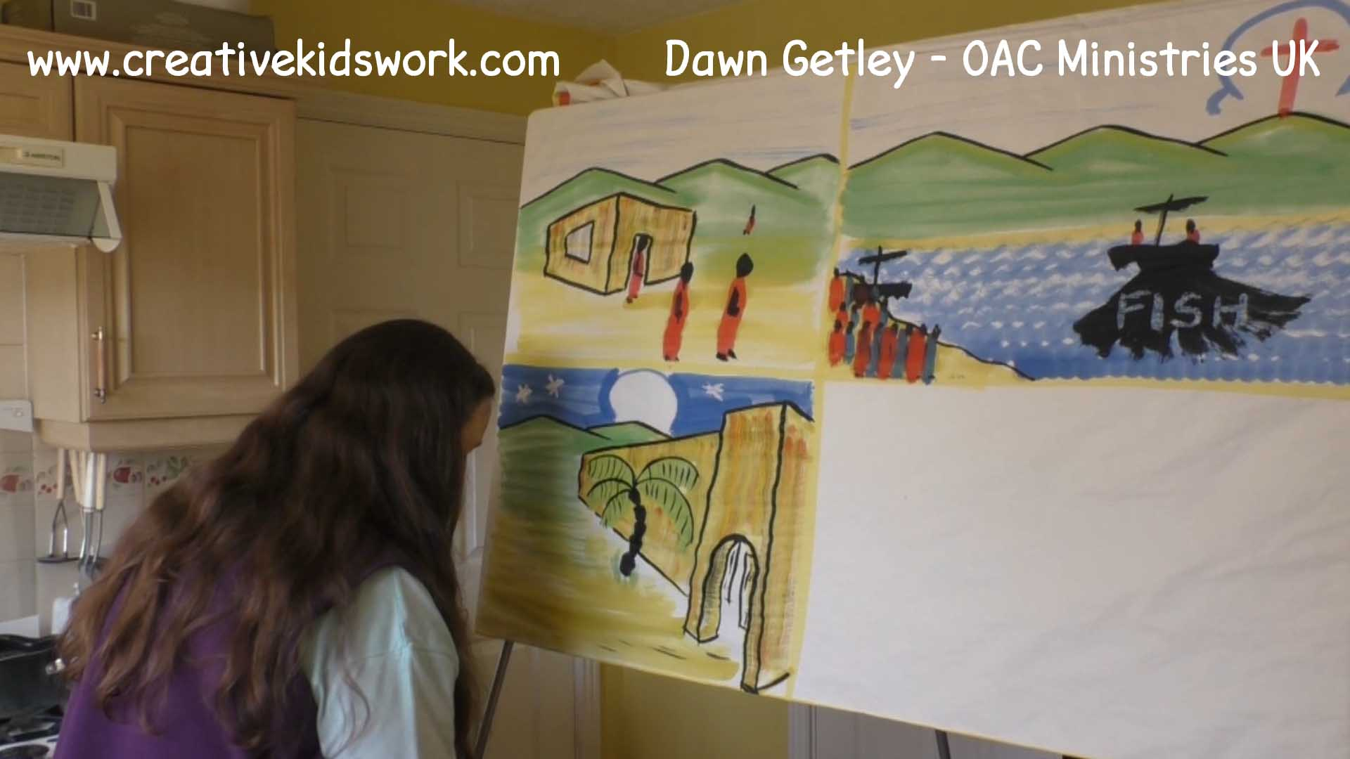 Dawn Getley demonstrates how to paint a city and a night sky on a sketchboard painting