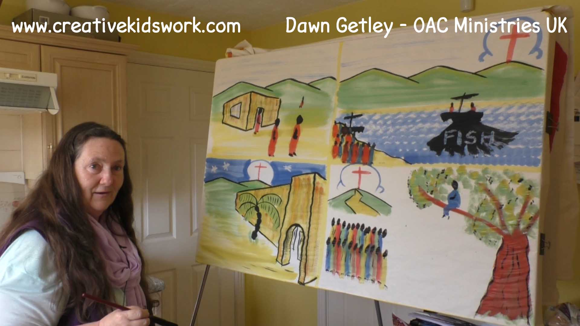 Dawn Getley demonstrates how to paint a road on a hill a crowd and a giant tree for the story of Zacchaeus on a sketchboard painting